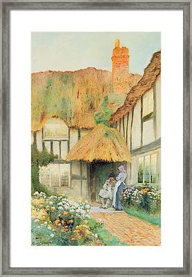 By The Cottage Door Framed Print by Arthur Claudes Strachan