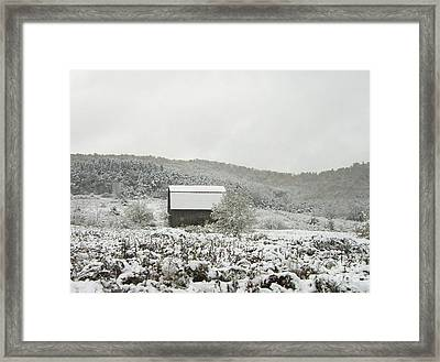 Cabin In The Snow Framed Print by Michael Waters