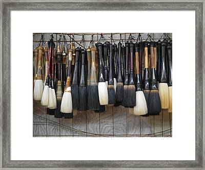 Calligraphy Brushes Hang On The Wall Framed Print by Justin Guariglia