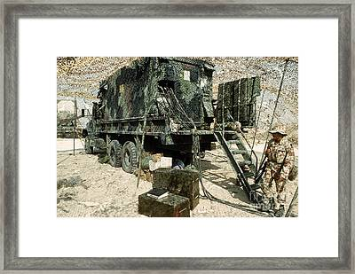 Camouflage Netting Covers A Cargo Truck Framed Print by Stocktrek Images