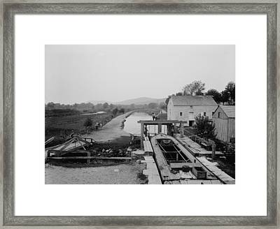 Canal Boat Passing Through A Lock Framed Print by Everett