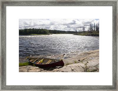 Canoe Pulled Up On The Shore Framed Print by Skip Brown