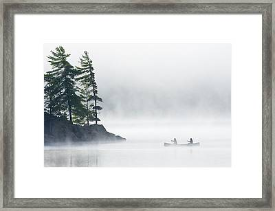 Canoeing Through Fog On Lake Of Two Framed Print by Mike Grandmailson