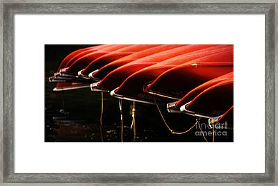 Canoes Of Red Framed Print by Bob Christopher