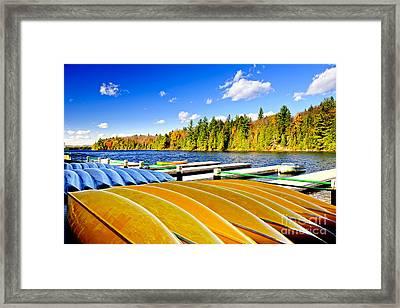 Canoes On Autumn Lake Framed Print by Elena Elisseeva