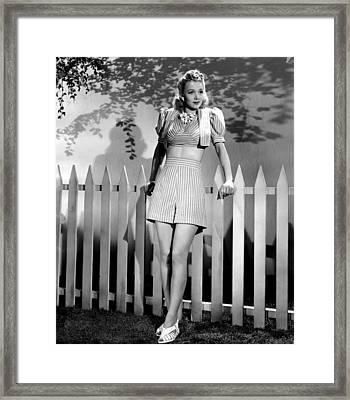 Carole Landis Modeling Striped Shorts Framed Print by Everett