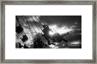 Carousel Swing Framed Print by Keith Kapple