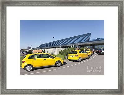 Cars Lining Up For Pickup At The Airport Framed Print by Jaak Nilson