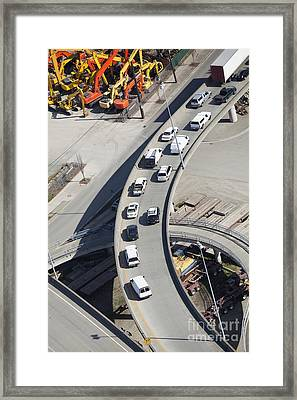 Cars On An Exit Ramp Framed Print by Don Mason