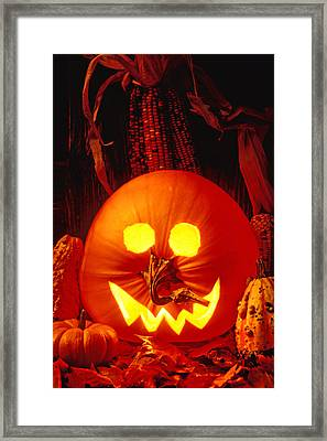 Carved Pumpkin With Fall Leaves Framed Print by Garry Gay