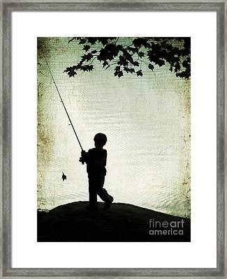 Catching Leaves Framed Print by Darren Fisher