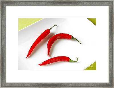 Cayenne Peppers Framed Print by HD Connelly
