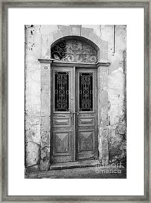 chained up wooden door to derelict house near the restricted area of the UN buffer zone Framed Print by Joe Fox