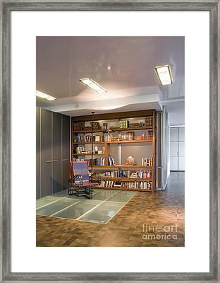 Chair On Glass Flooring Framed Print by Andersen Ross