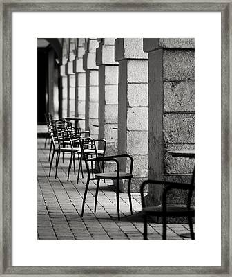 Chairs And Pillars  Framed Print by Marcio Faustino