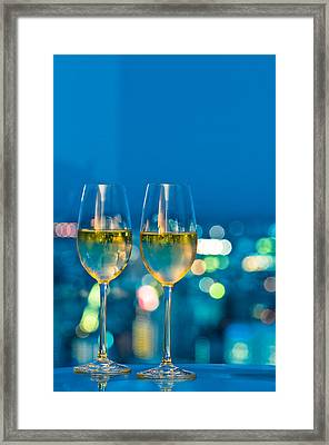 Champagne Glasses In Front Of A Window Framed Print by Ulrich Schade