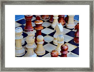 Checkmate Framed Print by Russ Harris