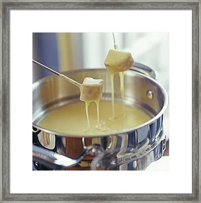 Cheese Fondue Framed Print by David Munns