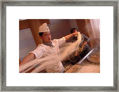 Chef Stretches Dough As He Makes Fresh Framed Print by Richard Nowitz