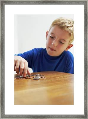 Child With Loose Change Framed Print by Ian Boddy