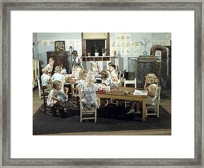 Children Play In A Day Nursery Framed Print by J. Baylor Roberts