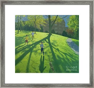 Children Running In The Park Framed Print by Andrew Macara