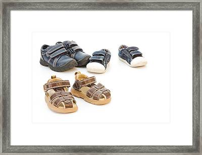 Childs Shoes Framed Print by Tom Gowanlock