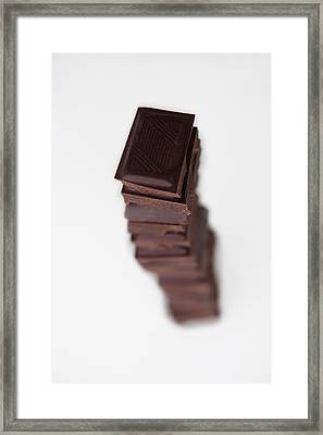 Chocolates Stacked Into Tower Framed Print by Asia Images
