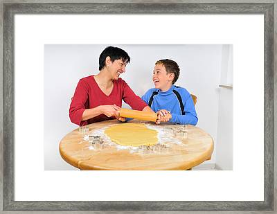 Christmas Baking - Mother And Son Laughing Framed Print by Matthias Hauser