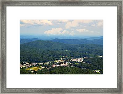 City In The Valley Framed Print by Susan Leggett