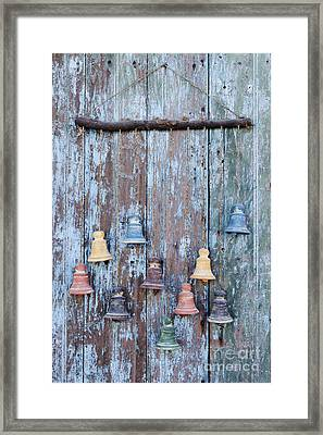 Clay Bells On A Weathered Door Framed Print by Jeremy Woodhouse