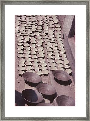 Clay Yogurt Cups Drying In The Sun Framed Print by David Sherman