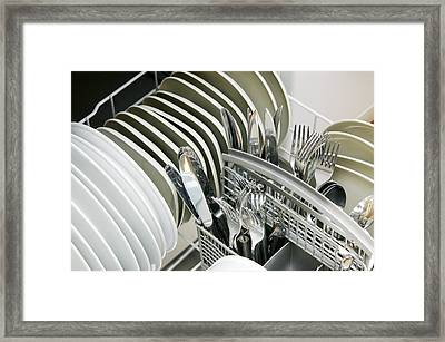 Clean Utensils In A Dishwasher Framed Print by Johnny Greig