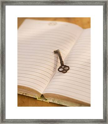Close Up Of Open Notebook With Key, Studio Shot Framed Print by Daniel Grill