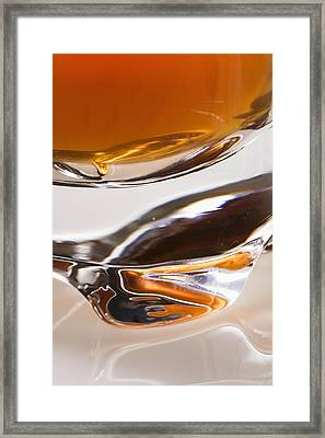 Close-up Of The Base Of A Glass Filled Framed Print by Michael Interisano