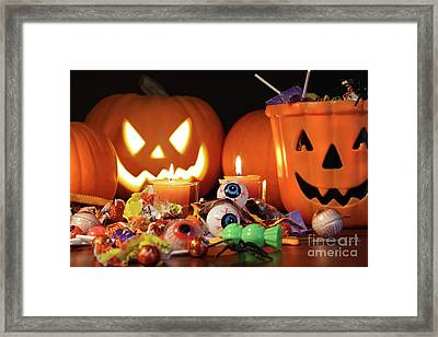 Closeup Of Candies With Pumpkins  Framed Print by Sandra Cunningham