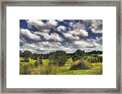 Clouds Floating Over Green Countryside Framed Print by Kaye Menner