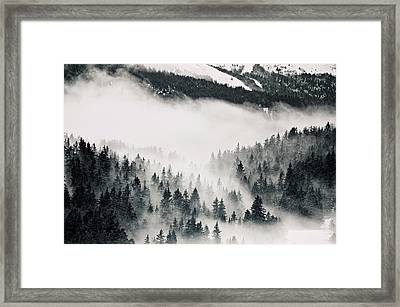 Clouds Moving Through Forest In French Alps Framed Print by Philipp Klinger