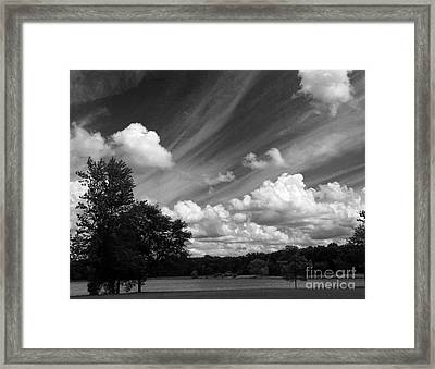Clouds Over The Lake 1 Framed Print by Cedric Hampton