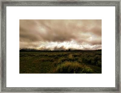 Clouds Over The Tetons Framed Print by Ellen Heaverlo