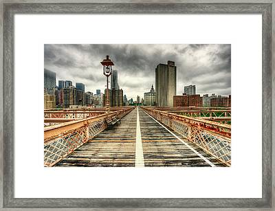 Cloudy New York From Brooklyn Bridge Framed Print by Ixefra