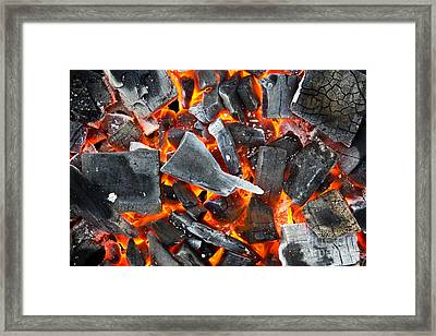 Coals In The Fire Framed Print by Mongkol Chakritthakool