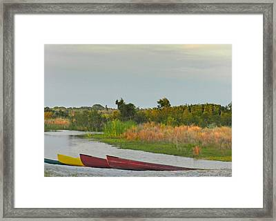 Colorful Canoes Framed Print by Grace Dillon