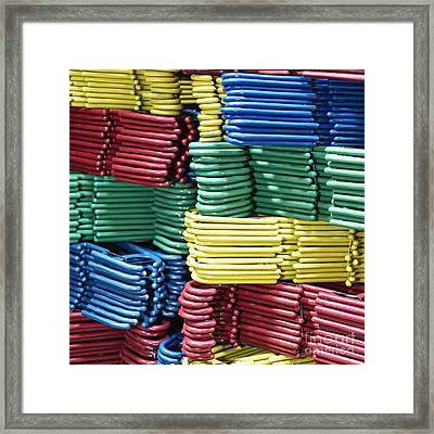 Colorful Clothes Hangers Framed Print by Skip Nall