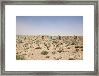 Colorful Row Of Barrels In The Desert Framed Print by Paul Edmondson