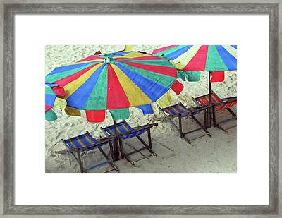 Colourful Deck Chairs And Umbrellas In Thailand Framed Print by Thepurpledoor