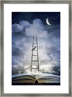 Conceptual Image Of Open Book With Ladder And Floating Clouds Framed Print by Sandra Cunningham
