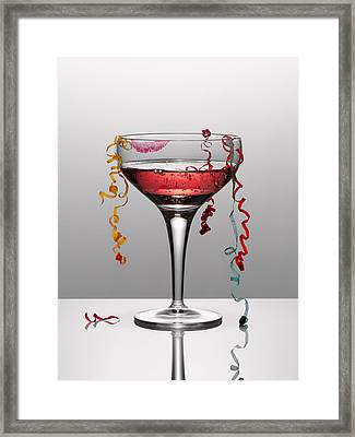 Confetti Hanging From Glass Of Pink Champagne With Lipstick Stain Framed Print by Andy Roberts