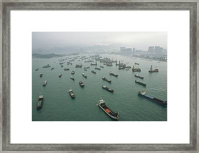 Container Ships In Hong Kong Harbor Framed Print by Justin Guariglia