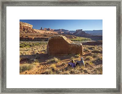 Contemplating The Petroglyphs Framed Print by Tim Grams